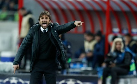 Chelsea head coach Antonio Conte gestures towards his players during their Champions League, group C, soccer match between Qarabag FK and Chelsea at the Baku Olympic stadium in Baku, Azerbaijan, Wednesday, Nov. 22, 2017. Chelsea won the game 4-0. (AP Photo/Pavel Golovkin)