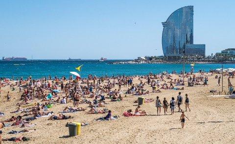 Norske turister i utlandet må belage seg på en svak krone mot euro i sommer, ifølge Nordea. Her fra Barcelona. Foto: Halvard Alvik (NTB scanpix)