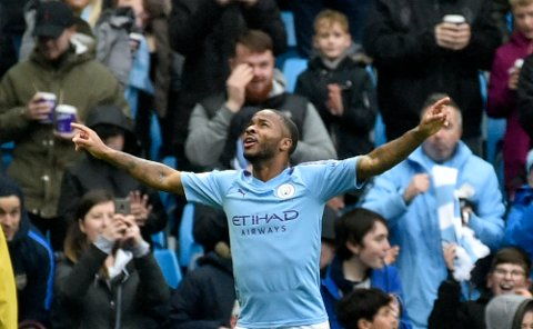 Manchester City's Raheem Sterling celebrates after scoring his side's first goal during the English Premier League soccer match between Manchester City and Aston Villa at Etihad stadium in Manchester, England, Saturday, Oct. 26, 2019. (AP Photo/Rui Vieira)