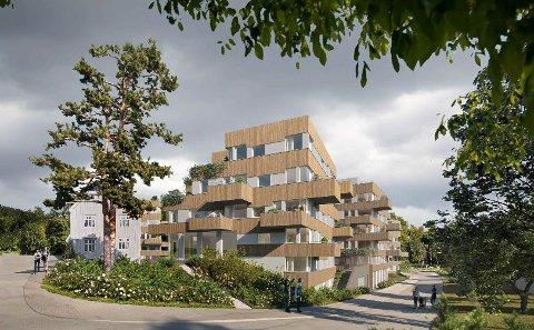 SLIK KAN DET BLI: Planen er å bygge 128 leiligheter fordelt på sju kvadratiske blokker. Til venstre det gamle landhandleriet som Fylesrådmannen ber om at blir bevart.