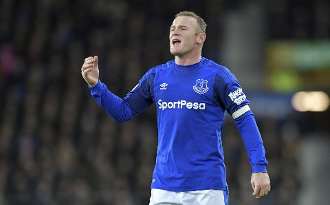 Everton's Wayne Rooney gestures during the English Premier League soccer match between Everton F.C and Huddersfield Town at Goodison Park,Liverpool, England. Saturday. Dec. 2, 2017. (Dave Howarth/PA via AP)