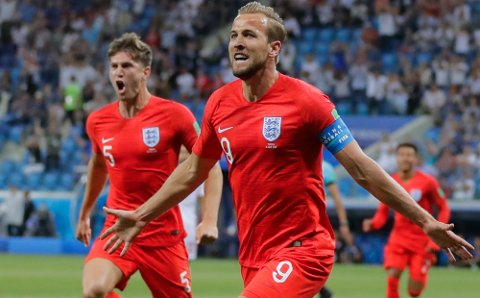 England's Harry Kane, foreground, celebrates after scoring his side's opening goal against Tunisia during the group G match between Tunisia and England at the 2018 soccer World Cup in the Volgograd Arena in Volgograd, Russia, Monday, June 18, 2018. (AP Photo/Sergei Grits)