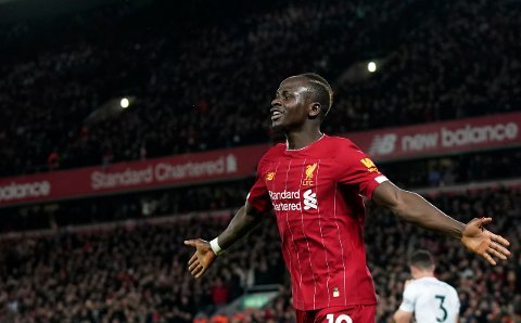 Liverpool's Sadio Mane celebrates after scoring his side's second goal during the English Premier League soccer match between Liverpool and Sheffield United at Anfield Stadium, Liverpool, England, Thursday, Jan. 2, 2020. (AP Photo/Jon Super)