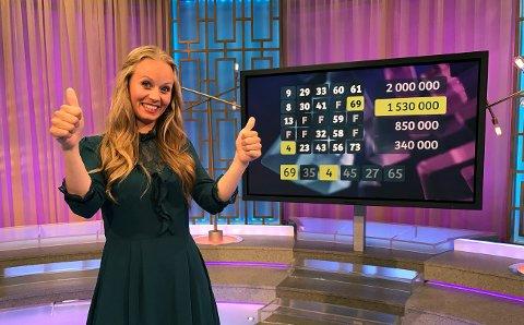TOMMEL OPP: Fem av tallene til Extra-kandidaten var på vinnerbrettet, og 28-åringen kan juble for 1.530.000 kroner på konto.