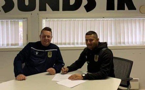 SIGNERTE: Ojan Bijan signerte lørdag ny kontrakt med EIK. Her sammen med daglig leder, Kenneth Andersen.