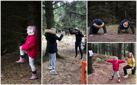Aktivitetsløypa har vært populær blant barna i Sørabygda. Her prøver Sonja (rød), Maja, Theo og Mathea (gul) seg på de ulike øvelsene i treningsløypa i Hålandsskogen.
