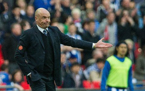Wigan Athletic's manager Uwe Rösler reacts, during their English FA Cup semifinal soccer match against Arsenal, at the Wembley Stadium in London, Saturday, April 12, 2014. (AP Photo/Bogdan Maran)
