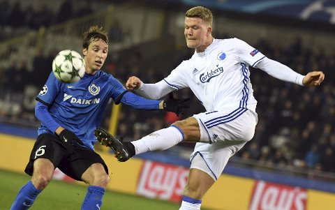 Copenhagen's Andreas Cornelius, right, kicks the ball while being challenged by Brugge's Tomas Pina during the Champions League Group G soccer match between Club Brugge and FC Copenhagen at the Jan Breydel stadium in Brugge, Belgium on Wednesday, Dec. 7, 2016. (AP Photo/Geert Vanden Wijngaert)