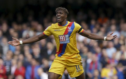 Crystal Palace's Wilfried Zaha appeals following a foul during their English Premier League soccer match between Chelsea and Crystal Palace at Stamford Bridge stadium in London Saturday, April 1, 2017. (AP Photo/Alastair Grant)