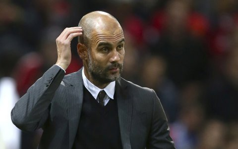 Manchester City's manager Pep Guardiola arrives pitch side ahead of the English League Cup soccer match between Manchester United and Manchester City at Old Trafford stadium in Manchester, England, Wednesday, Oct. 26, 2016. (AP Photo/Dave Thompson)
