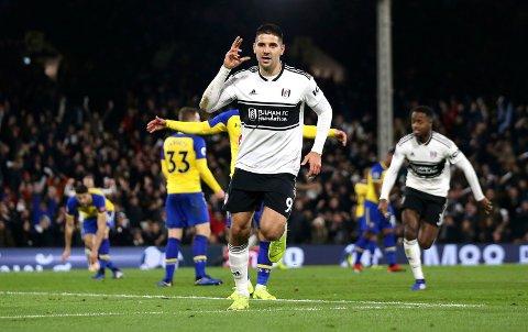 Fulham's Aleksandar Mitrovic celebrates after scoring during a Premier League soccer match between Fulham and Southampton, at Craven Cottage, London, Saturday Nov. 24, 2018. (Steven Paston/PA via AP)