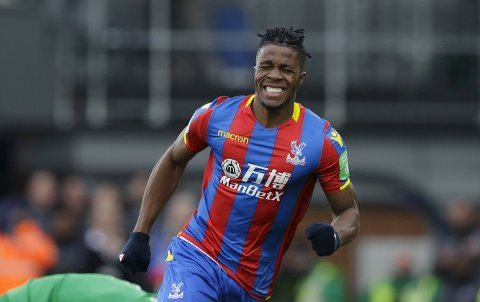 Crystal Palace's Wilfried Zaha reacts after missing a chance to score during the English Premier League soccer match between Crystal Palace and Liverpool at Selhurst Park stadium in London, Saturday, March, 31, 2018. (AP Photo/Alastair Grant)