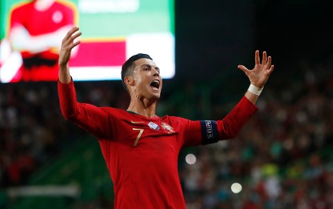 Portugal's Cristiano Ronaldo celebrates after scoring his side's second goal during the Euro 2020 group B qualifying soccer match between Portugal and Luxembourg at the Jose Alvalade stadium in Lisbon, Friday, Oct 11, 2019. (AP Photo/Armando Franca)