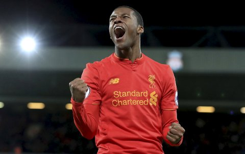Liverpool's Georginio Wijnaldum celebrates scoring his side's third goal against Arsenal during the English Premier League soccer match at Anfield, Liverpool, England, Saturday March 4, 2017. (Peter Byrne/PA via AP)(/PA via AP)