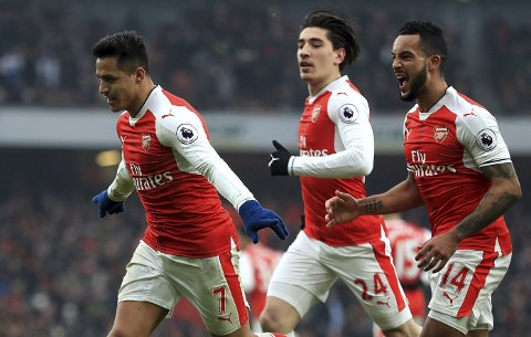 Arsenal's Alexis Sanchez, foreground, celebrates scoring the opening goal, during the English Premier League soccer  match between Arsenal and Hull City , at the Emirates Stadium, in London, Saturday, Feb. 11, 2017. (Adam Davy/PA via AP)