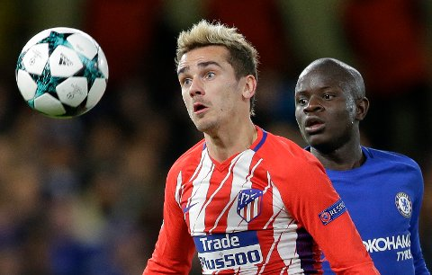 Chelsea's N'golo Kante, right, competes for the ball with Atletico's Antoine Griezmann during the Champions League Group C soccer match between Chelsea and Atletico Madrid at Stamford Bridge stadium in London Tuesday, Dec. 5, 2017. (AP Photo/Alastair Grant)