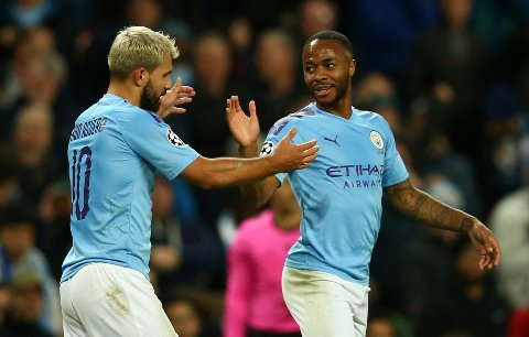 Manchester City's Raheem Sterling, left, celebrates with his teammate Sergio Aguero after scoring his side's fifth goal, during the group C Champions League soccer match between Manchester City and Atalanta at the Etihad Stadium in Manchester, England, Tuesday, Oct. 22, 2019. (AP Photo/Dave Thompson)