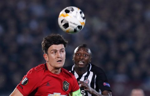 Manchester United's Harry Maguire challenges for the ball with Partizan's Umar Sadiq during the Europa League group L soccer match between Partizan Belgrade and Manchester United at the Partizan stadium in Belgrade, Serbia, Thursday, Oct. 24, 2019. (AP Photo/Darko Vojinovic)