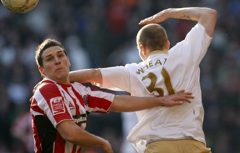 Sheffield United's Billy Sharp, left, jumps for the ball against Middlesbrough's David Wheater during their English FA Cup 5th round soccer match at Bramall Lane Stadium, Shefield, England, Sunday Feb. 17, 2008. (AP Photo/Jon Super)   **NO INTERNET/MOBILE USAGE WITHOUT FOOTBALL ASSOCIATION PREMIER LEAGUE(FAPL)LICENCE. EMAIL info@football-dataco.com FOR DETAILS. **