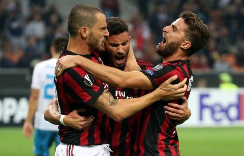 AC Milan's Matteo Musacchio, center, celebrates with his teammates Leonardo Bonucci, left, and Fabio Borini Bonucci after scoring during the Europa League group D soccer match between AC Milan and Rijeka, at the Milan San Siro Stadium, Italy, Thursday, Sept. 28, 2017. (Matteo Bazzi/ANSA via AP)