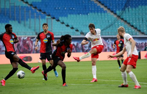 Leipzig's Patrik Schick, center, scores his side's second goal during the German Bundesliga soccer match between RB Leipzig and Hertha BSC at the Red Bull Arena in Leipzig, Germany, Wednesday, May 27, 2020. The German Bundesliga is the world's first major soccer league to resume after a two-month suspension because of the coronavirus pandemic. (Alexander Hassenstein/Pool via AP)