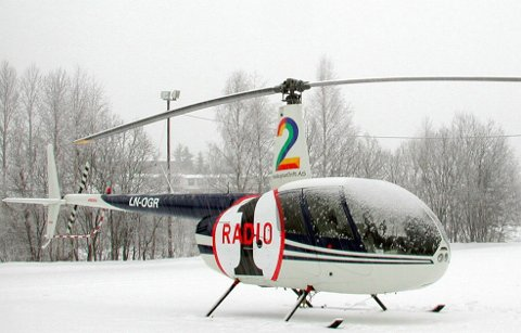 Radio 1 hadde i flere år et helikopter som overvåket trafikken i hovedstaden. Dette bildet er fra vinteren 2002, da helikopteret måtte landet på grunn av tett snøvær.