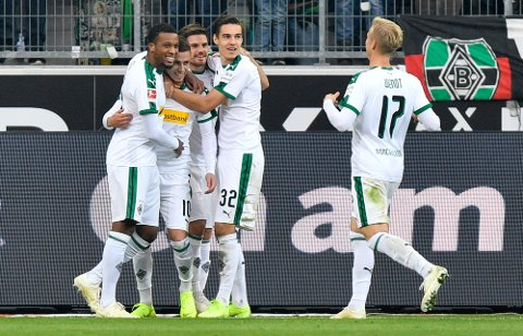Moenchengladbach's Thorgan Hazard is celebrated after scoring the opening goal during the German Bundesliga soccer match between Borussia Moenchengladbach and Fortuna Duesseldorf, Germany, Sunday, Nov. 4, 2018. (AP Photo/Martin Meissner)