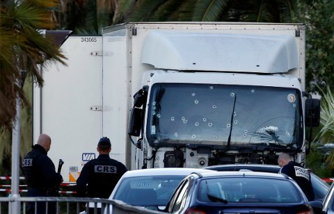 French CRS and judicial police work near the heavy truck that ran into a crowd at high speed celebrating the Bastille Day July 14 national holiday on the Promenade des Anglais killing 80 people in Nice, France, July 15, 2016.    REUTERS/Eric Gaillard