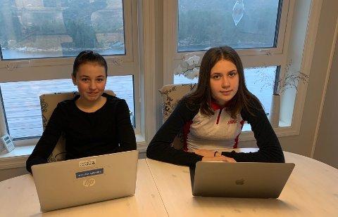 UTFORDRING:Emma Karoline(t.h) og søstera Hannah Aurora må gjere lekser og skulearbeid frå dataen i tida framover. Det krev internett, noko som kan bli utfordrande for familen.