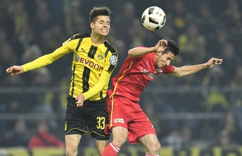 Dortmund's Julian Weigl, left, and Union's Steven Skrzybski challenge for the ball during the German Soccer Cup match between Borussia Dortmund and Union Berlin in Dortmund, Germany, Wednesday, Oct. 26, 2016. (AP Photo/Martin Meissner