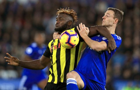 Watford's Isaac Success, left, and Leicester City's Jonny Evans battle for the ball during the English Premier League soccer match between Leicester City and Watford F.C at the King Power stadium, Leicester, England. Saturday Dec. 1, 2018. (Mike Egerton/PA via AP)