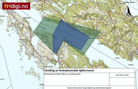 VIL UTVIDA: Dei nye grensene Sjøforsvaret har skissert, omfattar mellom anna store delar av eksisterande bustadfelt. Det eksisterande området er markert med blått, framlegget til ny, utvida sone er markert med grønt.ILLUSTRASJON: Meland kommune/NHDIGI.no