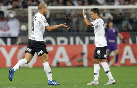 Roger of Brazil's Corinthians, left, celebrates with teammate Pedrinho, after scoring against Chile's Colo Colo, during a Copa Libertadores soccer match in Sao Paulo, Brazil, Wednesday, Aug. 29, 2018. (AP Photo/Andre Penner)