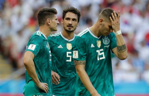 Germany's Mario Gomez, Mats Hummels and Niklas Suele, from left, react after Germany was eliminated during the group F match between South Korea and Germany, at the 2018 soccer World Cup in the Kazan Arena in Kazan, Russia, Wednesday, June 27, 2018. (AP Photo/Michael Probst)
