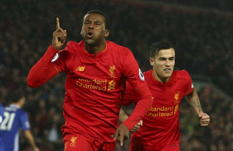 Liverpool's Georginio Wijnaldum, left, celebrates scoring a goal during the English Premier League soccer match between Liverpool and Chelsea at Anfield stadium in Liverpool, England, Tuesday, Jan. 31, 2017. (AP Photo/Dave Thompson)