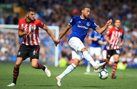 Southampton's Wesley Hoedt, left, and Everton's Cenk Tosun during their English Premier League soccer match at Goodison Park in Liverpool, Saturday Aug. 18, 2018. (Peter Byrne/PA via AP)