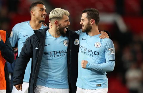 Manchester City's Sergio Aguero, center, and Manchester City's Bernardo Silva, right, celebrate at the end of the English Premier League soccer match between Manchester United and Manchester City at Old Trafford Stadium in Manchester, England, Wednesday April 24, 2019. Manchester City won 2-0. (AP Photo/Jon Super)