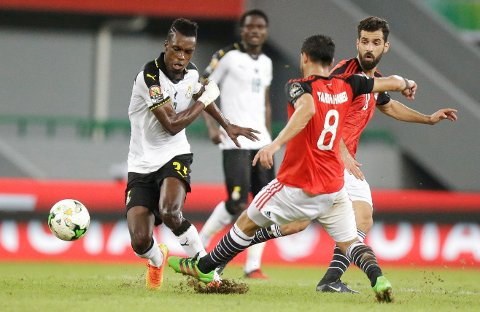 Egypt's Tarek Hamed, right, challenges Ghana's, John Boye, left, during their African Cup of Nations Group D soccer match between Egypt and Ghana at the Stade de Port-Gentil, in Port-Gentil, Gabon, Wednesday Jan. 25, 2017. (AP Photo/Sunday Alamba)