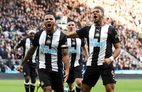 Newcastle United's Jamaal Lascelles, left, celebrates after scoring his side's first goal during the Premier League match between Newcastle and Wolverhampton at St. James' Park, Newcastle, Britain, Sunday Oct. 27, 2019.  (Owen Humphreys/PA via AP)