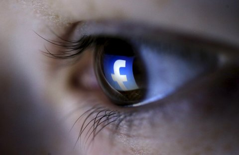 A file picture illustration shows a Facebook logo reflected in a person's eye, in Zenica, in this March 13, 2015 file photo. India introduced rules on February 8, 2016 to prevent Internet service providers from having different pricing policies for accessing different parts of the Web, in a setback to Facebook Inc's plan to roll out a pared-back free Internet service to the masses. REUTERS/Dado Ruvic/Files