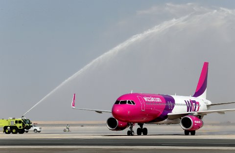 Wizz Air lands at the newly opened Al Maktoum International Airport in Dubai, United Arab Emirates, Sunday, Oct. 27, 2013. The first passengers have arrived at Dubai?s newest airport, part of the United Arab Emirates? plans to become a major air travel destination. A flight carrying a little more than 100 passengers from Budapest touched down Sunday at Dubai?s new Al Maktoum International Airport. (AP Photo/Patrick Castillo, Emarat Al Youm)