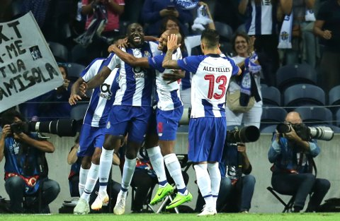 Porto forward Moussa Marega, center left, celebrates after scoring the opening goal during the Champions League group D soccer match between FC Porto and Galatasaray at the Dragao stadium in Porto, Portugal, Wednesday, Oct. 3, 2018. (AP Photo/Manuel Araujo)