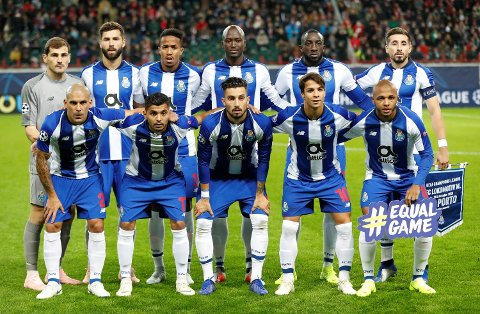 FC Porto starting players pose for a team photo at the beginning of the Group D Champions League soccer match between Lokomotiv Moscow and FC Porto at the Lokomotiv Stadium in Moscow, Russia, Wednesday, Oct. 24, 2018. (AP Photo/Pavel Golovkin)