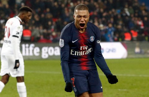 PSG's Kylian Mbappe celebrates after scoring his side's eighth goal during the League One soccer match between Paris Saint Germain and Guingamp at the Parc des Princes stadium in Paris, Saturday, Jan. 19, 2019. (AP Photo/Michel Euler)