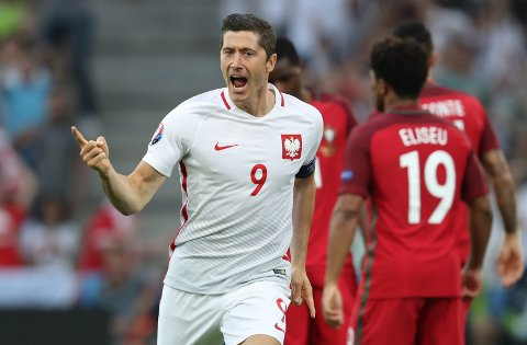 Poland's Robert Lewandowski celebrates after scoring the opening goal during the Euro 2016 quarterfinal soccer match between Poland and Portugal, at the Velodrome stadium in Marseille, France, Thursday, June 30, 2016. (AP Photo/Thanassis Stavrakis)