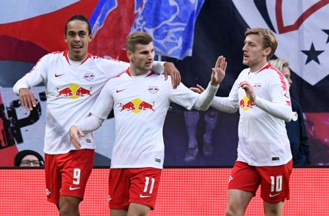Leipzig's Yussuf Poulsen, left, celebrates after scoring his side's 2nd goal with his teammates Leipzig's Timo Werner, center, and Leipzig's Emil Forsberg during the German first division Bundesliga soccer match between RB Leipzig and 1. FC Nuremberg in Leipzig, Germany, Sunday, Oct. 7, 2018. (AP Photo/Jens Meyer)