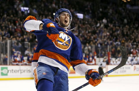New York Islanders center Brock Nelson (29) celebrates his game-winning goal in overtime of an NHL hockey game against the Toronto Maple Leafs, in New York, Monday, Feb. 6, 2017. The Islanders defeated the Maple Leafs 6-5. (AP Photo/Kathy Willens)