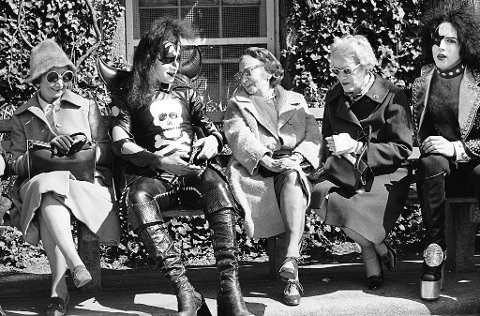 NEW YORK - APRIL 30:  Gene Simmons (second from left) and Paul Stanley (R) of American hard rock band KISS on the street near Central Park on April 30, 1974 in New York City.  (Photo by Waring Abbott/Getty Images)