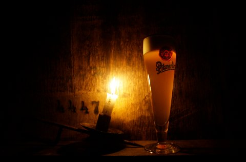 A glass of unpasteurized beer is seen at the Pilsner Urquell factory in Pilsen, Czech Republic, Sunday, March 29, 2009. The faintly bitter lager first produced in the Pilsner Urquell factory more than a century ago gave rise to a style of beer that has since circled the globe. Much of today's lager-style beer, in fact, owes its flaxen color and crisp flavor to a brewing process formulated in this small metropolis in the Czech Republic's Bohemia region. Its name still reflects its origins: Pilsner, Pilsener, or sometimes just Pils. (AP Photo/Petr David Josek)