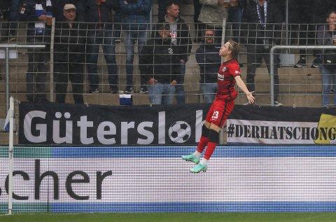 Frankfurt's Jens Petter Hauge celebrates after he scores the opening goal during the German Bundesliga soccer match between  Arminia Bielefeld and Eintracht Frankfurt in Bielefeld, Germany, Saturday, Aug. 28, 2021. (Friso Gentsch/dpa via AP)